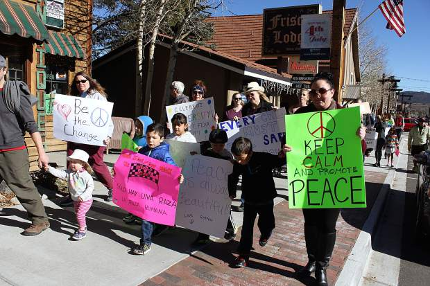 Demonstrators walked on Main Street in Frisco for a peace rally against discrimination and bullying in schools.