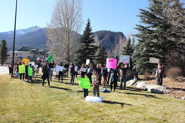 Summit County Moms organized a non-political rally to speak out against bullying and discrimination in schools. They stopped at the corner of Main Street and Summit Boulevard to wave at drivers.
