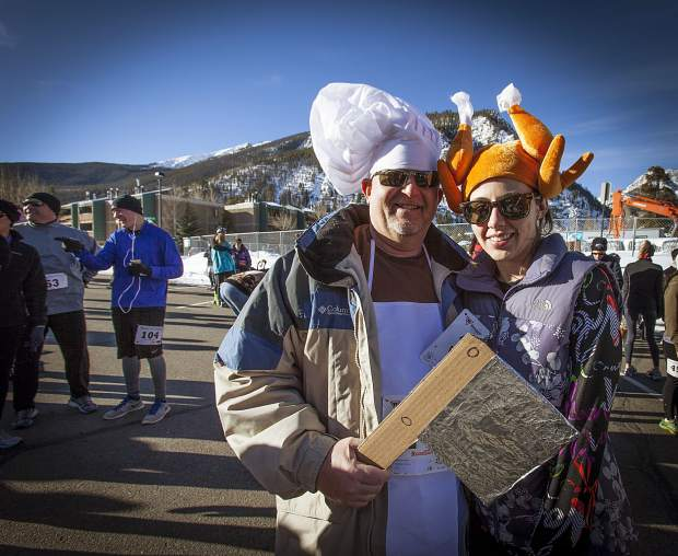 A chef and turkey on Main Street Frisco after the Turkey Day 5K in 2015. The fun-run event returns to Frisco on Thanksgiving Day with costumed runners on a mellow course split between in-town rec paths and streets.