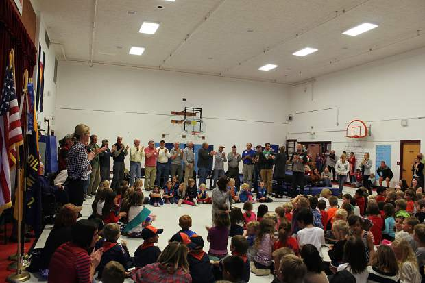 Veterans that presented at Frisco Elementary stood to recognize the work of the Parent Teacher Student Association in organizing the event for Veteran's Day.