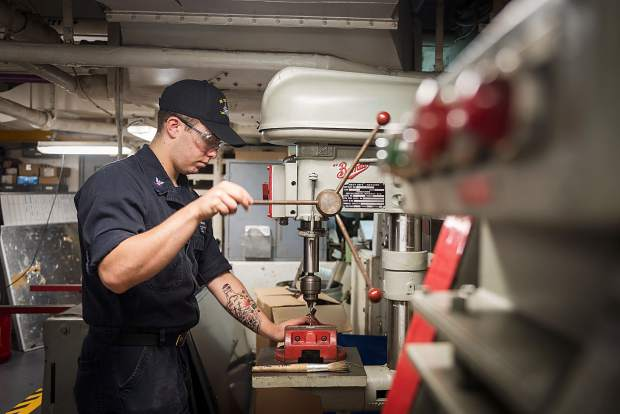 Hull Maintenance Technician 3rd Class Ryan Osborn, from Leadville, Colorado, drills a bracket in the repair shop aboard USS John C. Stennis (CVN 74). Stennis is conducting a routine maintenance availability following a deployment to U.S. 7th and 3rd fleet areas of operation.