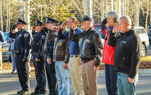 Veterans joined the Silverthorne Police Department in a salute during an early morning flag raising ceremony in honor of Veteran's Day.