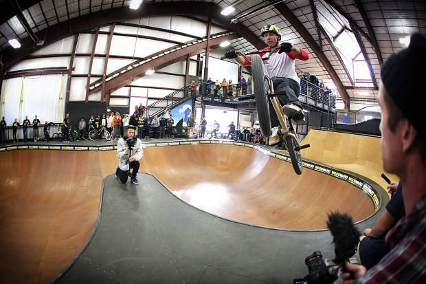 A BMX rider airs over the spine in the big bowl at the Woodward Copper Barn. On Nov. 12, Woodward hosts the Woodward Barn Bash, a free afternoon of drop-in and intro sessions, music, skate demos and jam competitions, followed by the local premieres of two snowboard videos.
