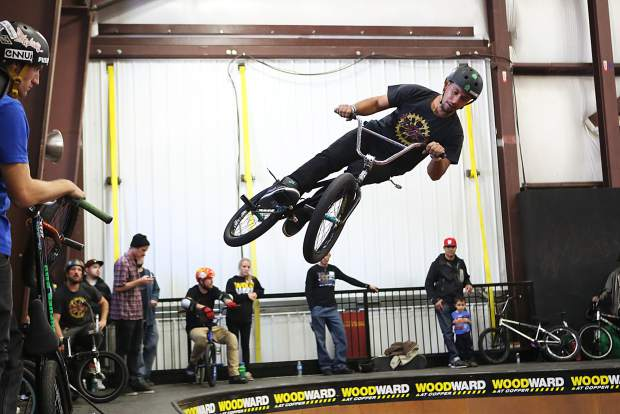 A BMX rider airs out of the big bowl at the Woodward Copper Barn. On Nov. 12, Woodward hosts a day of free intro and drop-in sessions, along with a skate jam and BMX jam for giveaways and prizes.