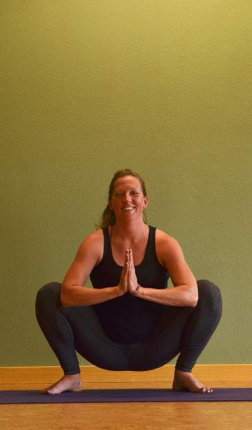 Frog pose for prenatal yoga.