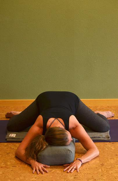 Child's pose with support for prenatal yoga.