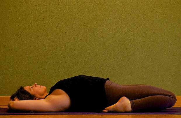 Fully reclined Saddle Yin yoga pose for joint mobility.