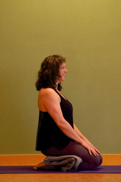 Saddle Yin yoga pose for joint relief.