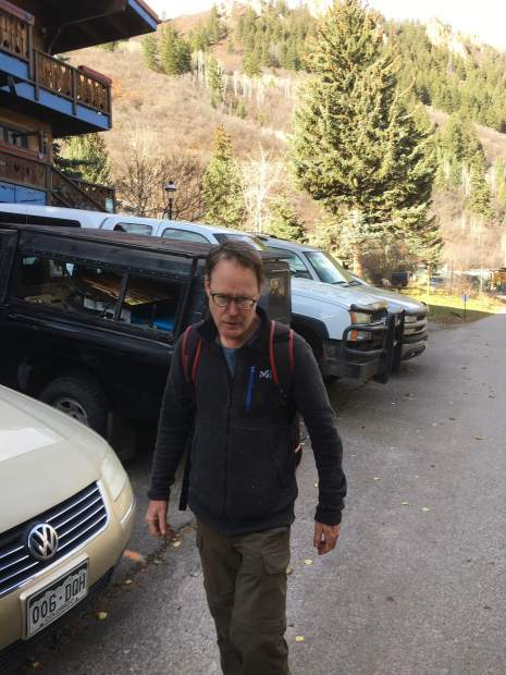 An Aspen Skiing Co., employee snapped this picture of James Hogue on Tuesday after catching him trying to build a shack near the remains of another cabin that was dismantled after authorities found it in September. Hogue, a 57-year-old notorious con man, has since disappeared.