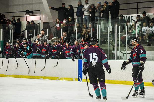 The Breck Vipers bench celebrates after a goal during the team's home opener against the Vail Yeti on Nov. 12. The Vipers lost, 3-6.