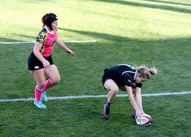 Meghan Sprockett with the Summit Black team scores a try against Swarm during the final for the state rugby sevens championship in Glendale on Nov. 12. Summit won, 10-5, to claim its ninth consecutive state title.