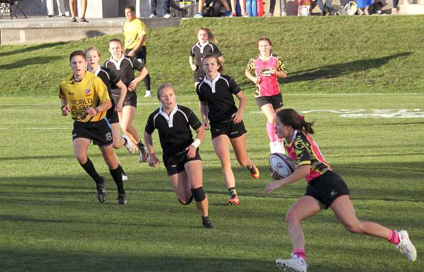 The Summit Black team plays against the Denver Swarm during the State High School Girls Rugby Sevens Championship in Glendale on Nov. 12. The Summit Black team took first with a 10-5 victory over Swarm to claim the team's ninth consecutive state title.
