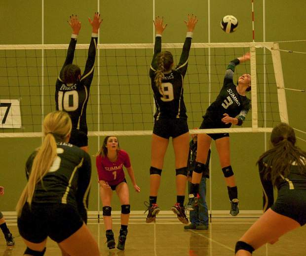 Summit's Emma McComb (No. 3) goes for a kill against the Battle Mountain line as teammate Sage Kent (No. 1) looks on during the team's Senior Night game at home on Oct. 25.