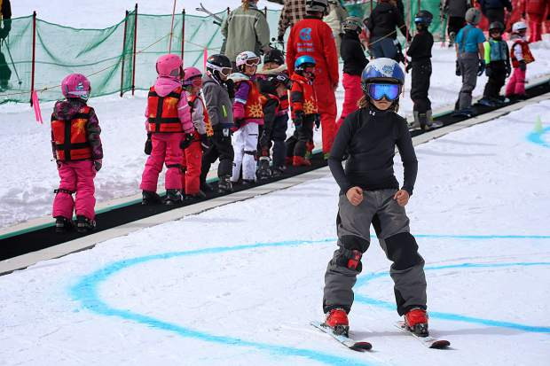 A young skier turns down the learning slope at Copper Mountain with a carpet lift in the background. Local instructors and coaches weigh in on the top mistakes every beginner of any age makes on skis.
