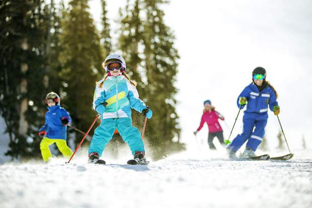 A young skier smiles her way down the learning slope during a ski lesson at Keystone Resort. Instructors recommend a first-day lesson for all beginners, no matter how young or old.