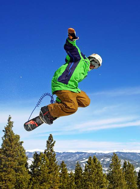 Longtime snowskater Clayton Conway throws a method off a jump in the Park Lane terrain park at Breckenridge Ski Resort Feb. 17. Conway redesigned his deck and ski almost immediately to handle bigger jumps when he started riding about a decade ago.
