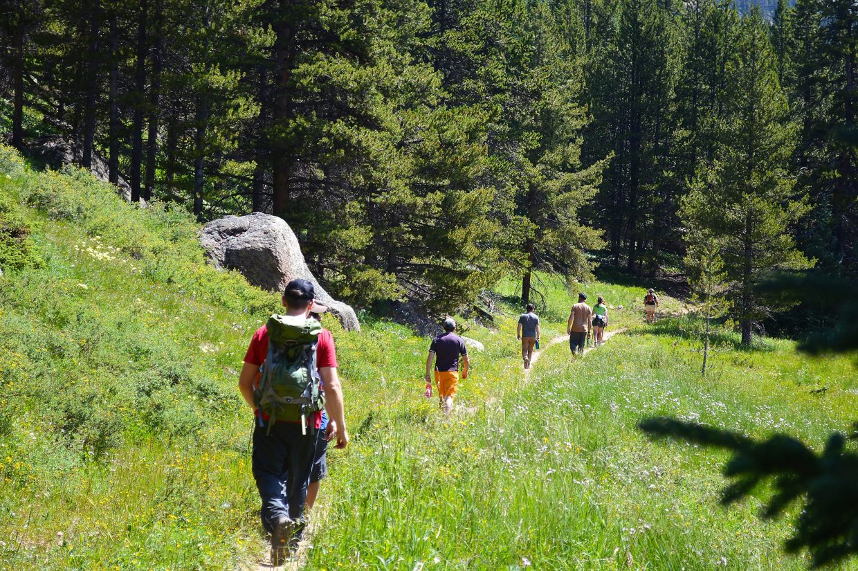 Veterans, advocates and hikers carried backpacks up Kokomo Pass on Saturday, July 30.
