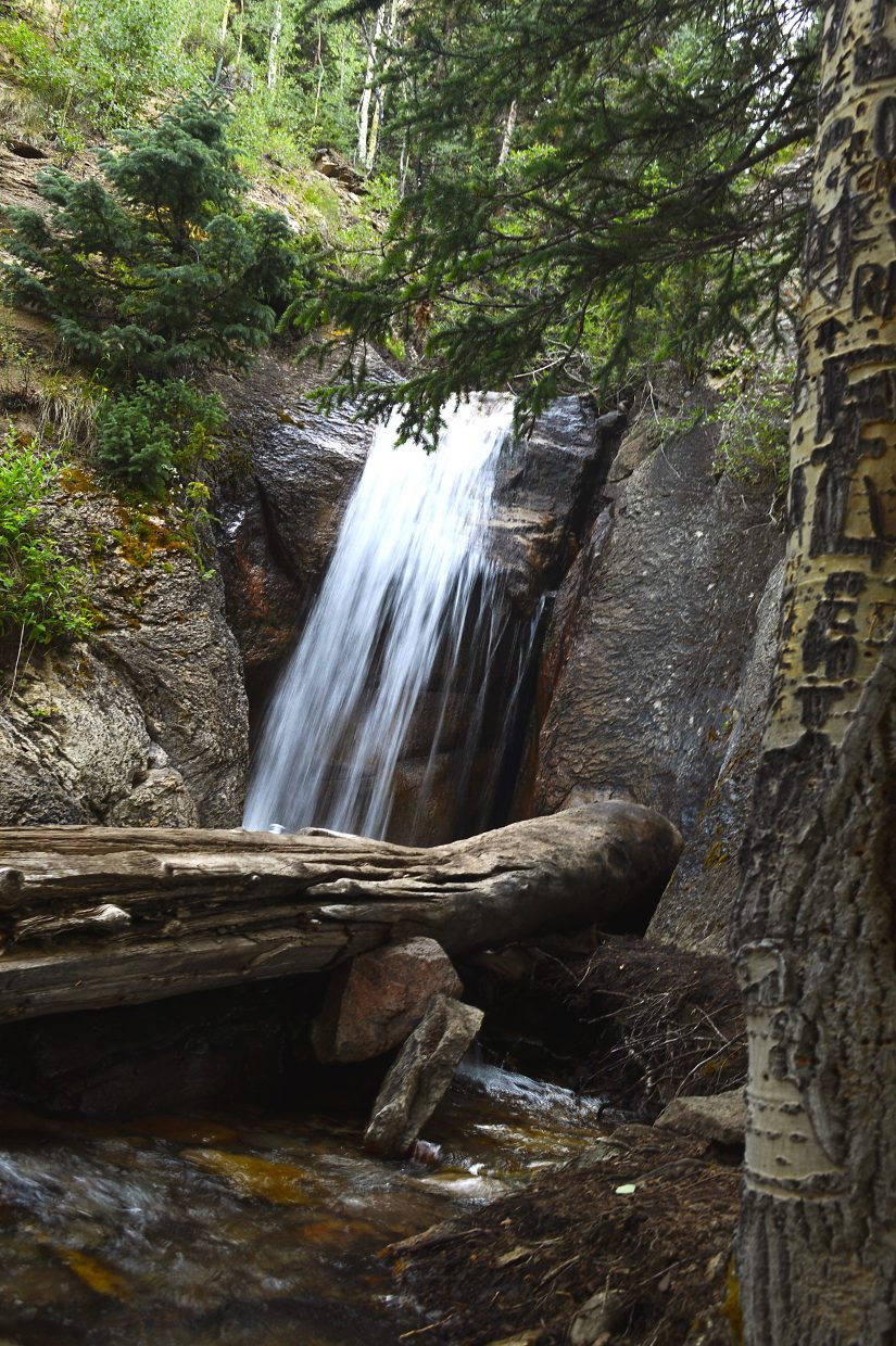 A waterfall marks the beginning of the trail up to Kokomo Pass.