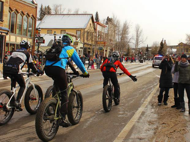A group of fat bikers leave Main Street Breckenridge as fans take photos during the start of the second annual Fat Bike Open, hosted Dec. 3 on trails in French Gulch.