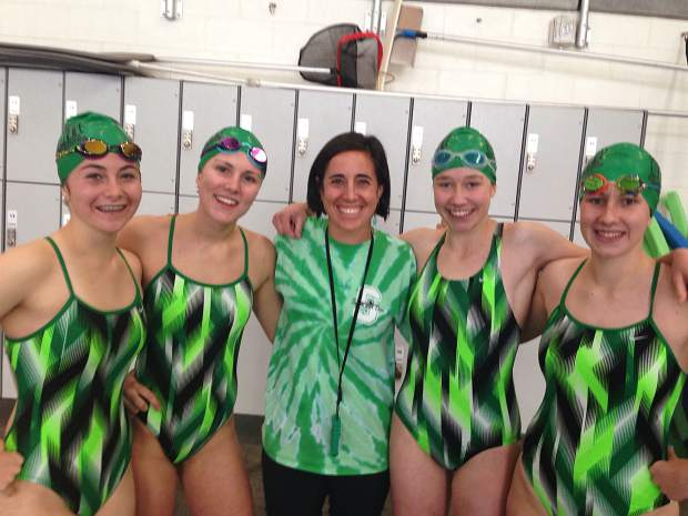 The Summit High School girl's varsity swimming relay team with head coach Jenny Wischmeyer (center) after qualifying for two 4A state freestyle relays — the first time for Summit swimmers in 16 years. The team qualified for the 200 freestyle relay (1:51.06) and the 400 freestyle relay (4:11.05).