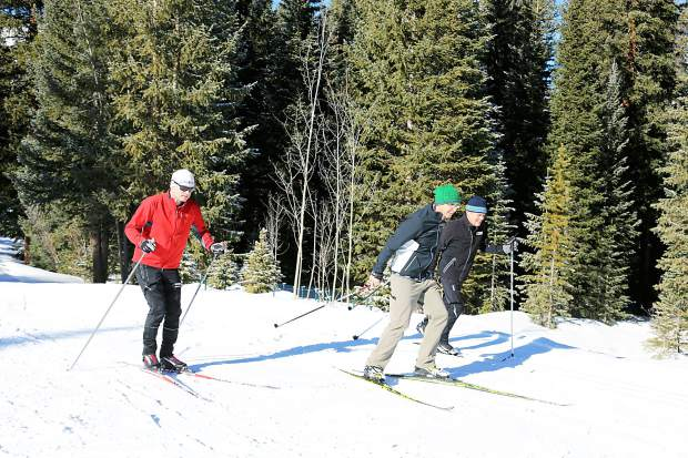 Josh, Matthew and Gene Dayton playfully take to the trails at the Breckenridge Nordic Center.  The majority of Nordic centers in Summit County are open as of Dec. 1, with more trails to follow with more snowfall.