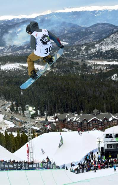 A competitor in the Dew Tour snowboard halfpipe semifinal at Breckenridge spins with burn pile smoke far in the background. In place of superpipe this season, Dew Tour debuts a new two-part slopestyle contest for men's and women's skiers and snowboarders on Dec. 9, 10 and 11.