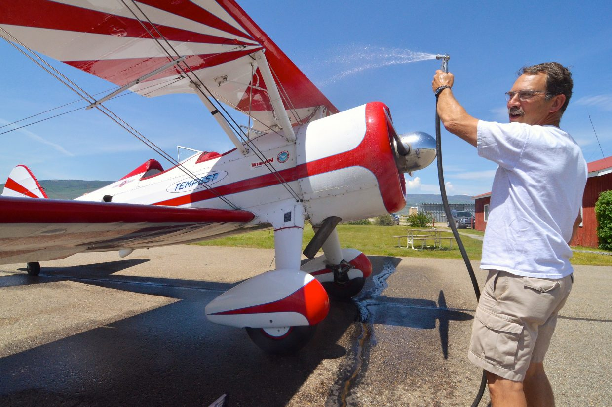 Pilot Gary Rower cleans his WWII-ear PT-17 biplane at the Kremmling Airport a week before the Dillon Airshow. Rower joins seven other pilots for the show, dubbed 'the highest airshow on Earth' from the Dillon Marina at 9,000 feet.