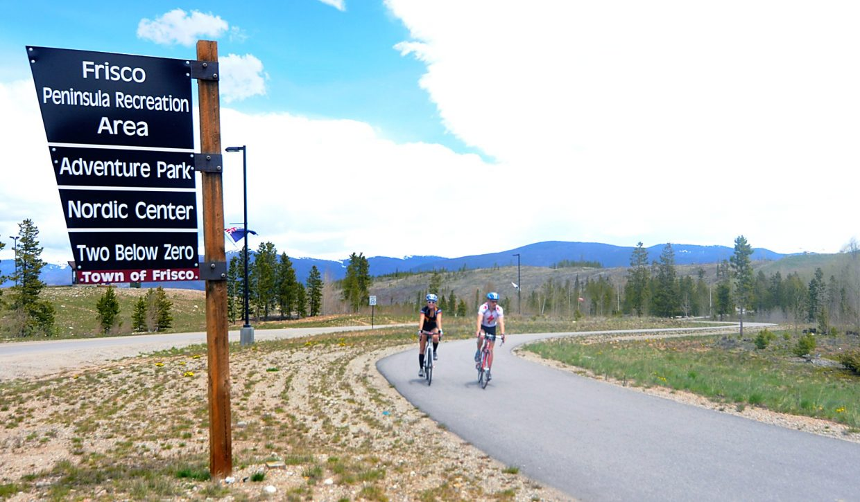 The west entrance to the Frisco Peninsual trail system at Frisco Adventure park. The lower parking lot leads to a paved rec path that connects to singletrack and fire road trails.