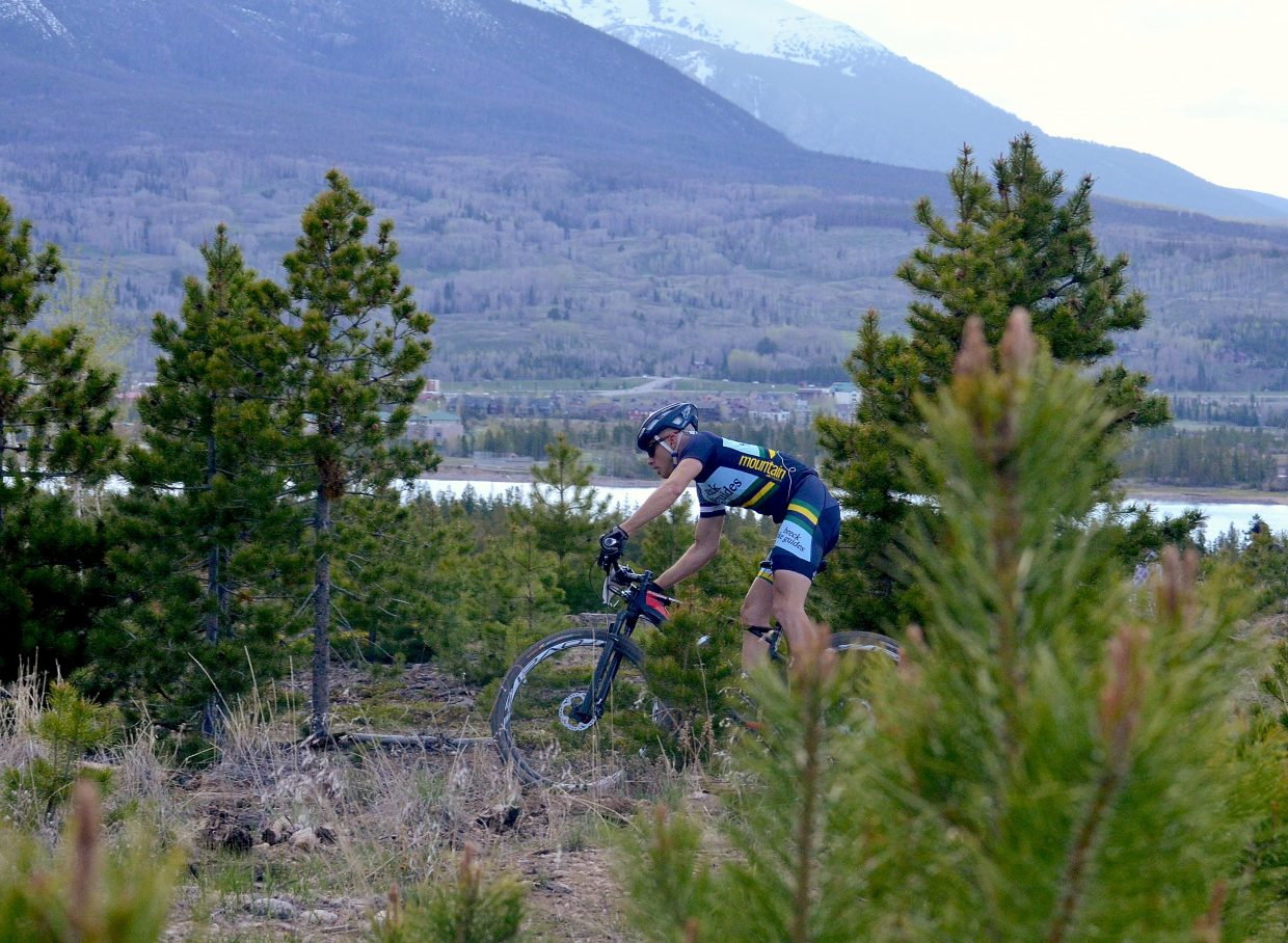 Mike Schilling weaves through the trees ahead of the pack on the first lap of the Frisco Roundup at the Frisco Peninsula June 1. Schilling won the race — and the first title of the race series 30th anniversary — with a time of 1:35:04 on the 21-mile course.