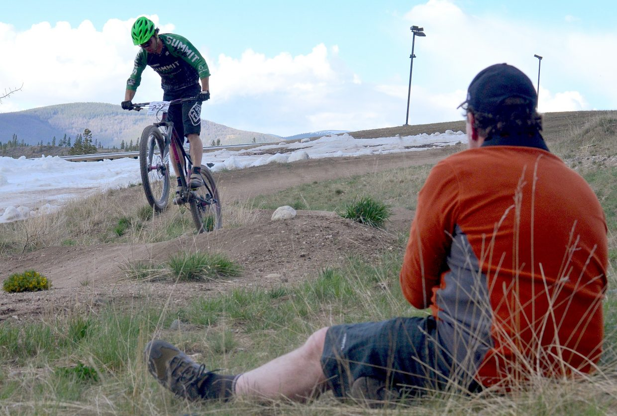 Andrew Dunlap takes a wheelie through the lower pump track during the Frisco Roundup on the Frisco Peninsula June 1. The race kicked off the 30th anniversary season for the local mountain bike series.