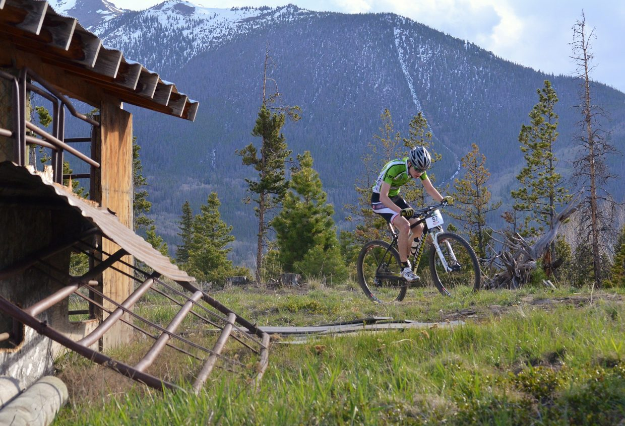 A cyclist passes by the horse stables on the Frisco Peninsula during the 2016 Frisco Roundup on June 1. The Peninsula trails and roads are home to the opening race of the 2016 Colorado High School Cycling mountain bike season from Aug. 27-28.