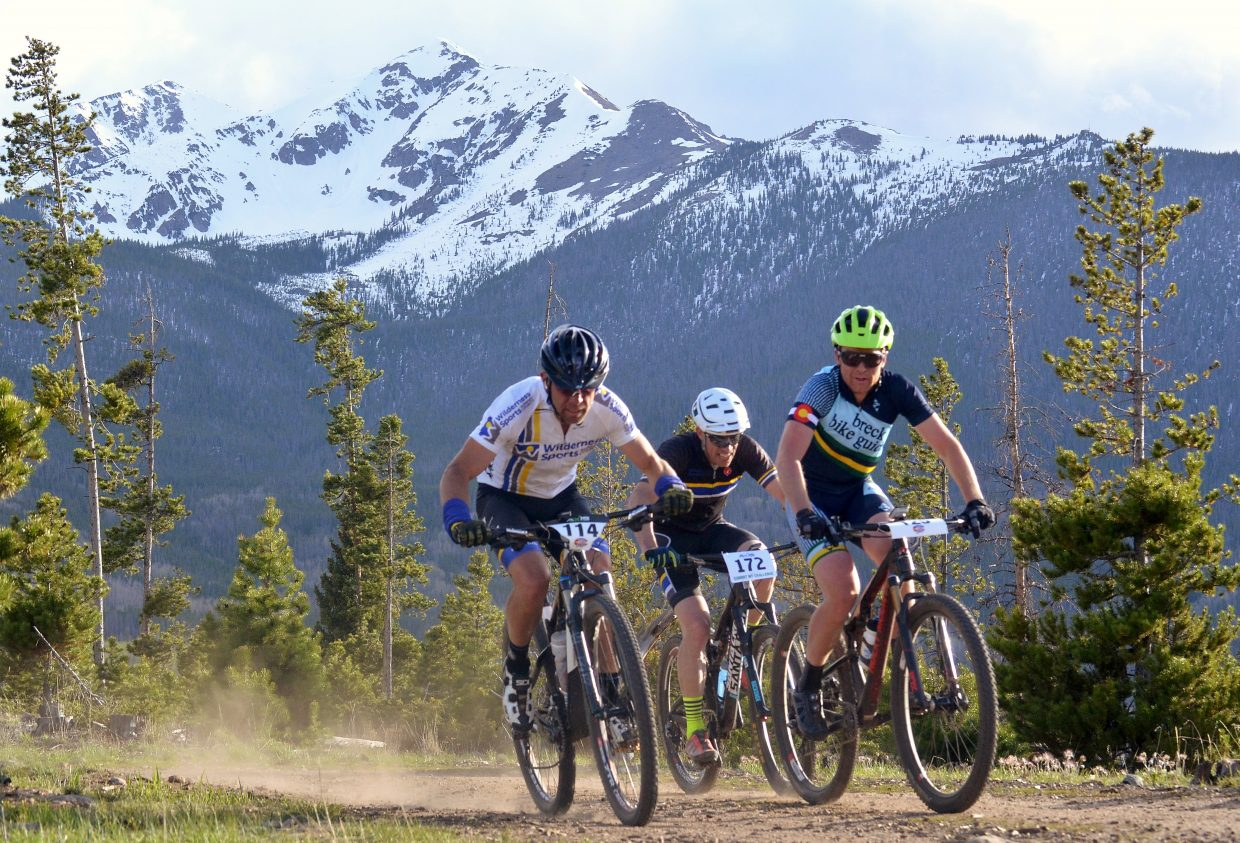 A trio of riders (from left) Darron Cheek, Jeff Cospolich and Nick Truitt bump elbows at the start of the 2016 Frisco Roundup on the Frisco Peninsula June 1. The race kicked off the 30th anniversary season for the local mountain bike series.