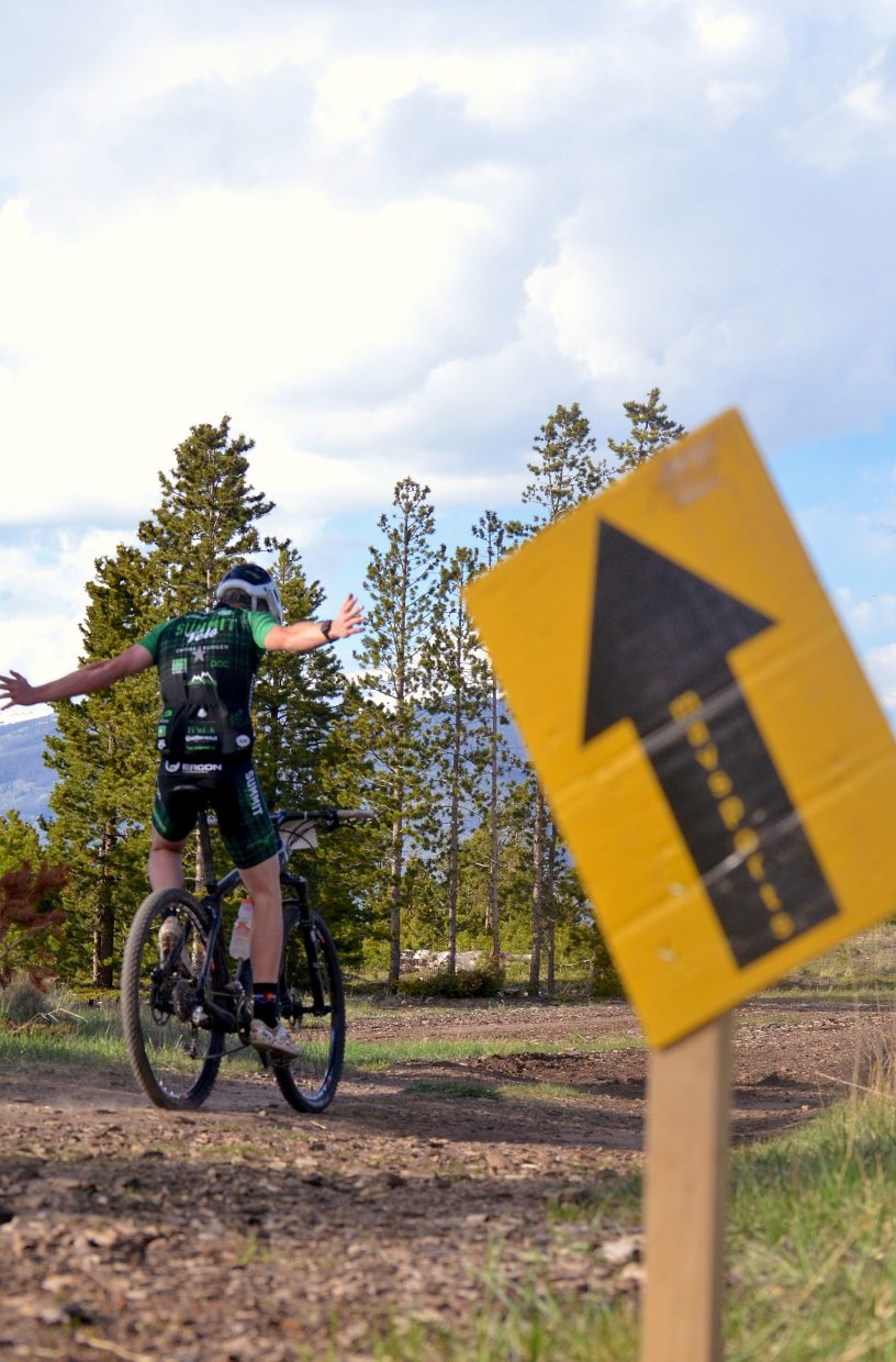 A Summit High School rider passes one of the first trail signs with style at the 2016 Frisco Roundup on the Frisco Peninsula June 1. The race kicked off the 30th anniversary season for the local mountain bike series.