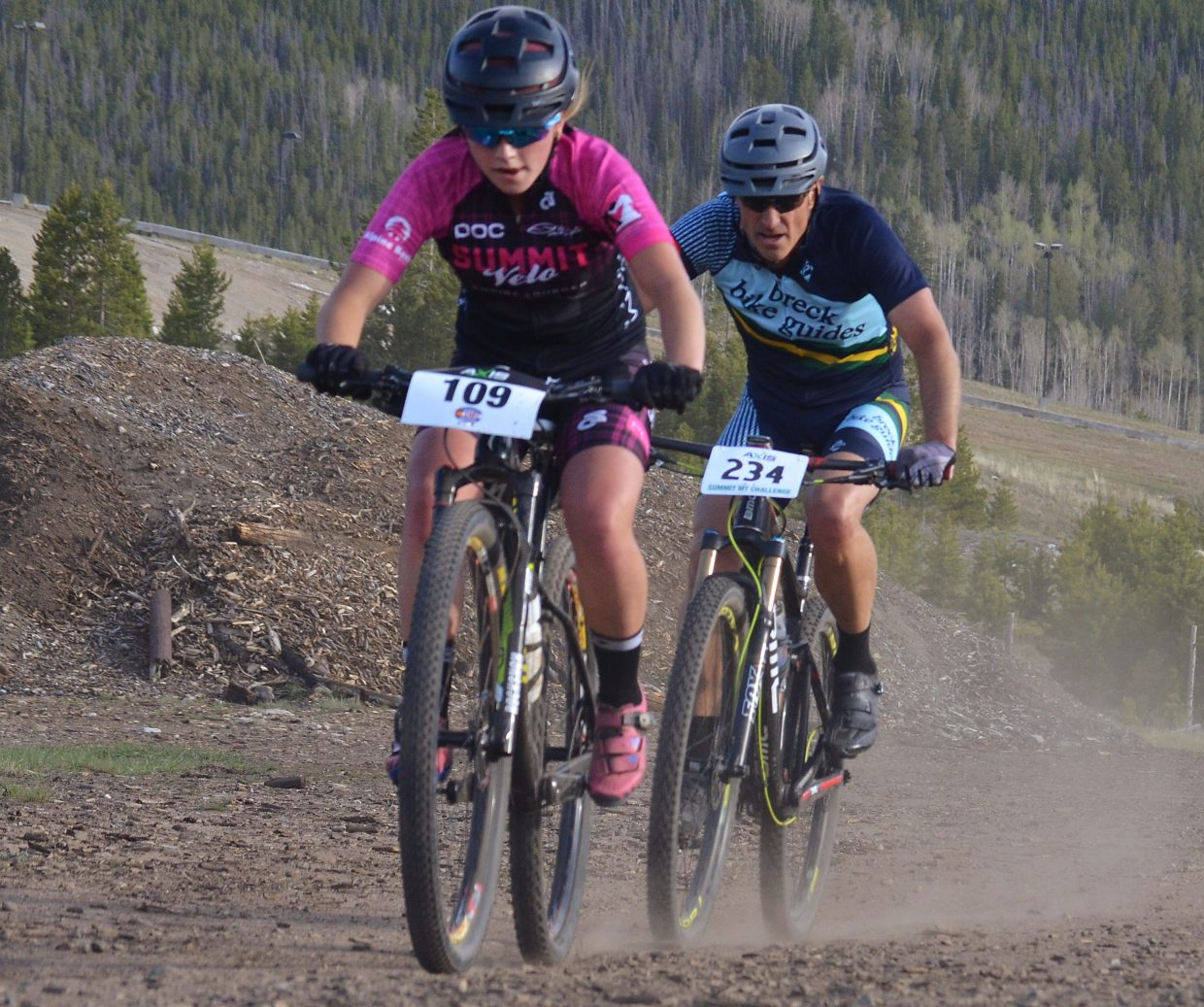 Young Ezra Smith (front) gets chased down by Wayne Thebeau at the 2016 Frisco Roundup on the Frisco Peninsula June 1. The Peninsula trails and roads are home to the opening race of the 2016 Colorado High School Cycling mountain bike season from Aug. 27-28.