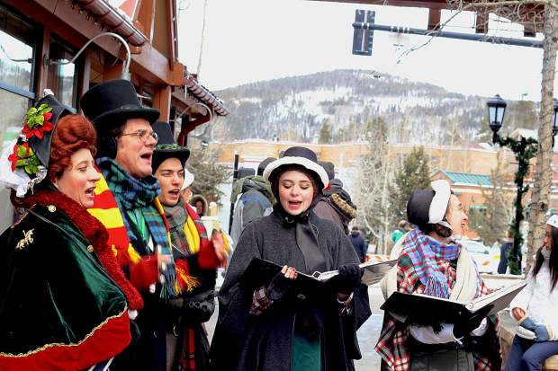 Carolers dressed in Victorian garb sang on Main Street in Breckenridge for the town's Saturday holiday festivites.