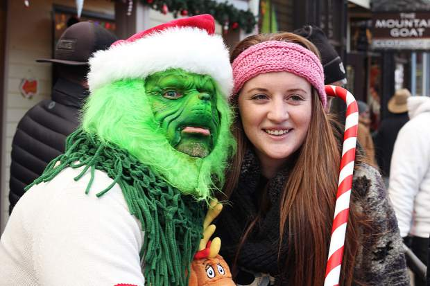 The Grinch posed with a spectator before the Race of the Santas in Breckenridge.