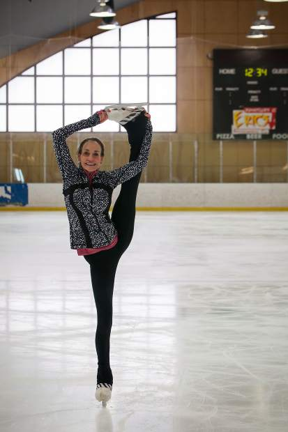 Local adult skater Lee Chandler demonstrates her expertise and flexibiity on the indoor ice skating rink in Breckenridge,