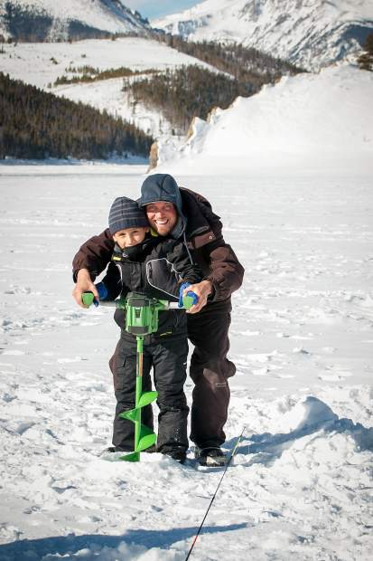 Eight-year-old Ignacio Hernandez traveled all the way from Puerto Rico to learn ice fishing from Alpine Fishing Adventrues guide, George Peebles.