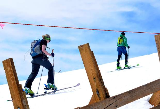 Skiers pass by wind fences on Imperial Ridge in the final stretch of the 2016 Imperial Challenge at Breckenridge on April 22. On average, cross-country skiing burns 563+ calories/hour, while uphill skinning burns about 1,161 calories/hour.