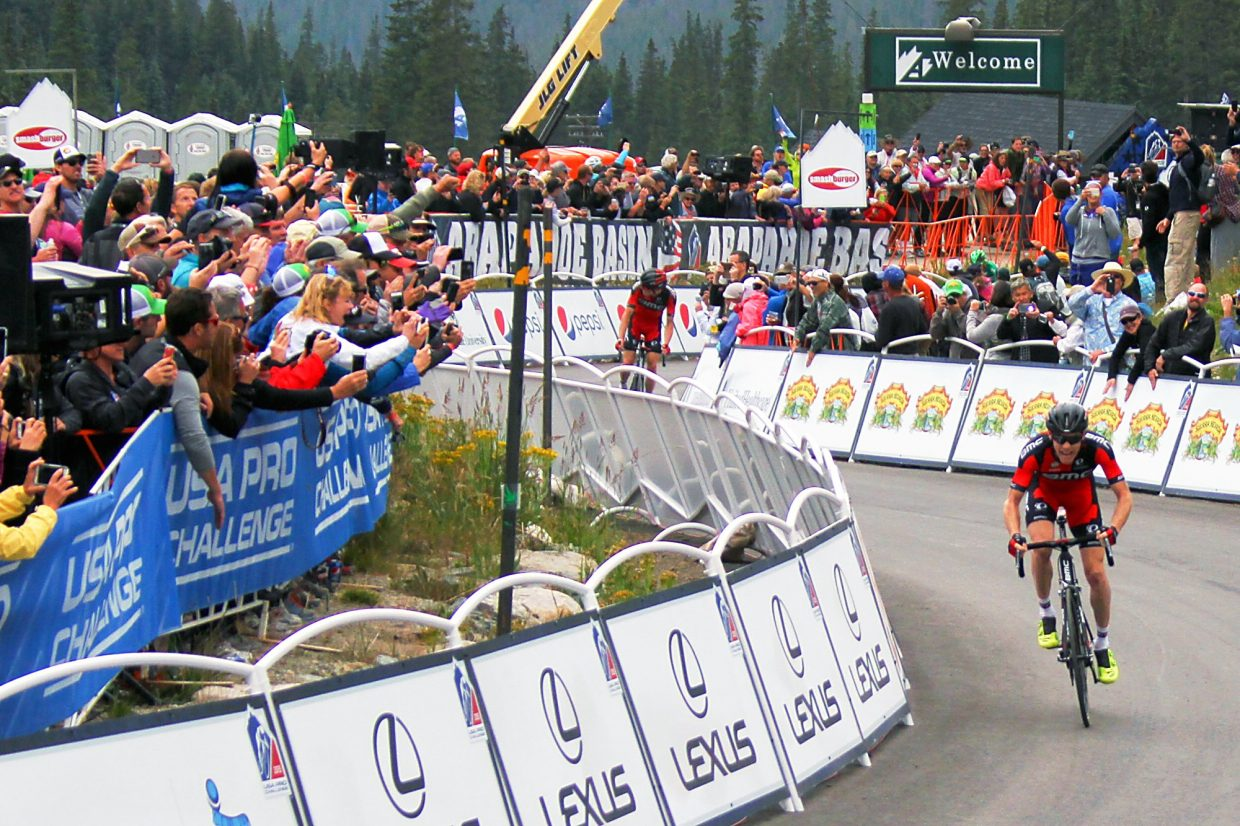 BMC Racing's Brent Bookwalter charges to the finish line after pulling ahead of teammate Rohan Dennis for the win at Stage 2 of the 2015 USA Pro Challenge at Arapahoe Basin on Aug. 18.