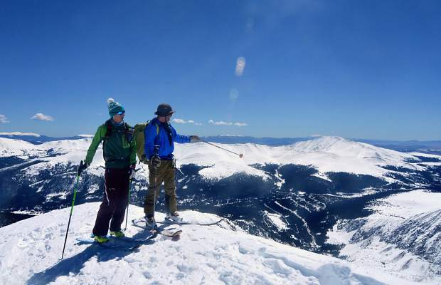 Fritz Sperry (right) points to a line on the south side of Quandary Peak (14,265 feet) as ski partner Teague Holmes looks on.
