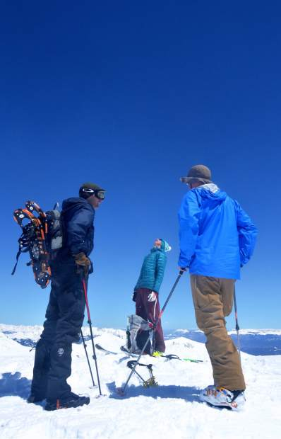 Piers Peterson (left) and Fritz Sperry (right) talk with local ski-mountaineering pro Teague Holmes at the summit of Quandary Peak (14,265 feet) in early May. Peterson and Sperry know each other through Peterson's brother, Jesse, who died in a 2012 ski accident on a nearby peak. Their meeting that morning was pure coincidence.