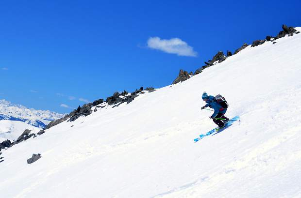 Blue River local Teague Holmes makes untouched turns on the upper section of Cristo Couloir, a 3,150-foot line from the summit of Quandary Peak (14,265 feet) to a high-alpine tarn near his home.