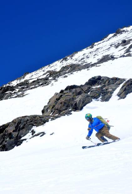 Fritz Sperry enjoys his final few turns near the base of the Cristo Couloir, a popular route from the summit of Quandary Peak (14,265 feet). Conditions on the runout range from fully covered to bare in May, depending on snowfall and daytime temperatures.