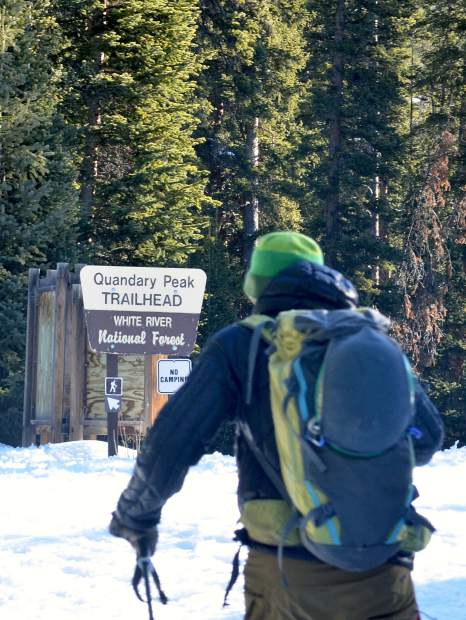 Fritz Sperry passes the Quandary Peak trailhead sign early in the 5.2-mile trek from the trailhead to the summit at 14,265 feet.