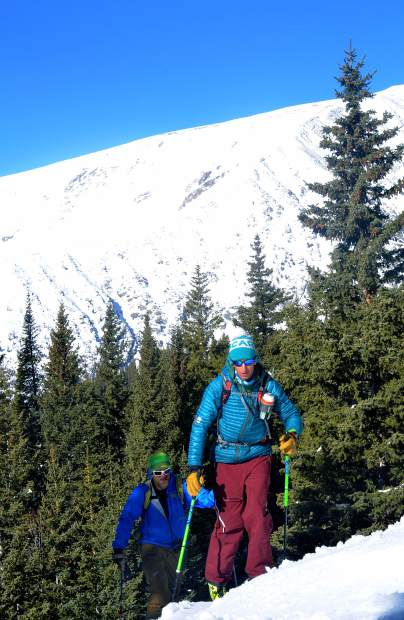 Teague Holmes (front) and Fritz Sperry skin through a wooded section in the first mile of the Quandary Peak east trail. In May, conditions and coverage in this stretch can vary wildly and slow groups unfamiliar with their gear.