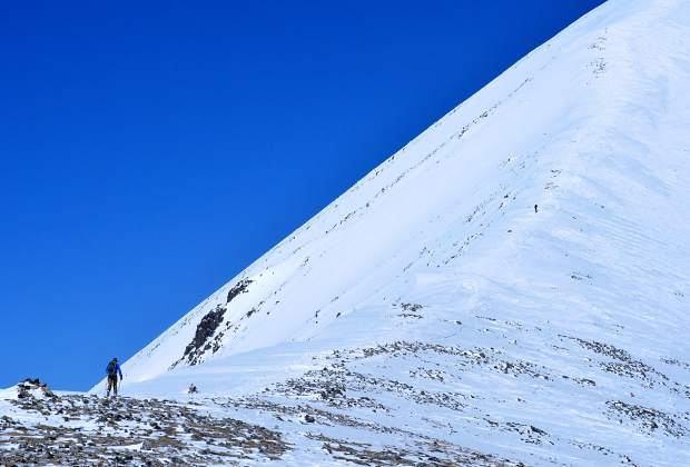 Fritz Sperry (below, left) skins along the East Ridge to the summit of Quandary Peak (14,265 feet). The backcountry route is one of Colorado's popular for ski touring and high-alpine skiing