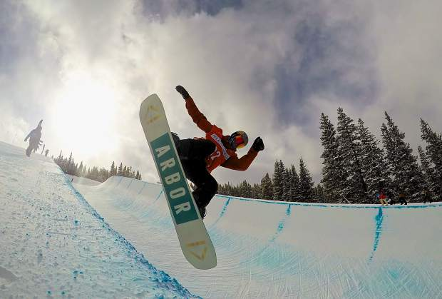 A snowboarder airs out of the superpipe at Copper Mountain during practice for the U.S. Revolution Tour on Dec. 7. Competition begins today with snowboarding and ends on Saturday with freeski superpipe.