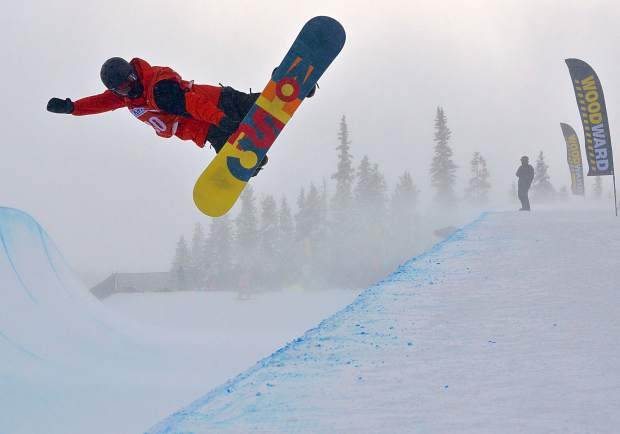 A snowboarder throws a method out of the Copper Mountain superpipe during practice for the U.S. Revolution Tour on Dec. 7. Competition begins today with snowboard superpipe and ends Dec. 10 with ski superpipe.