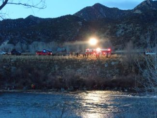 Lonnie Root / Provided Crews work Saturday to recover a body from the Colorado River.